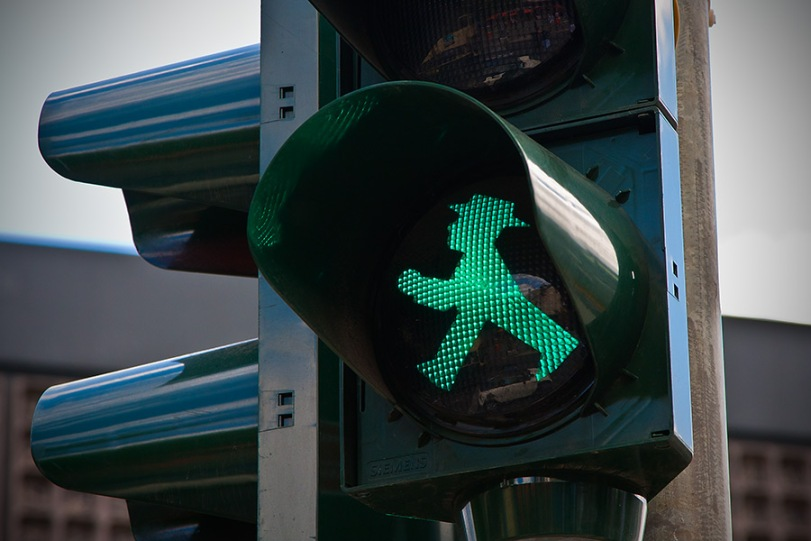 These are what the crosswalk signs look like in Berlin - a throwback more to the communist era of East Berlin. He is the Ampelmänn!
