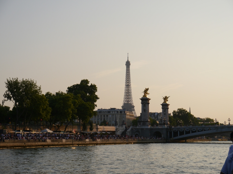 A great way to experience the banks of the Seine is on a river cruise! Or, buy a bottle of wine and a baquette and sit on the banks and watch the crowds!