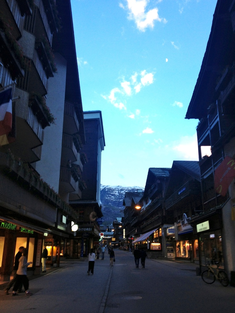 The low-key and car-free main street of Zermatt.