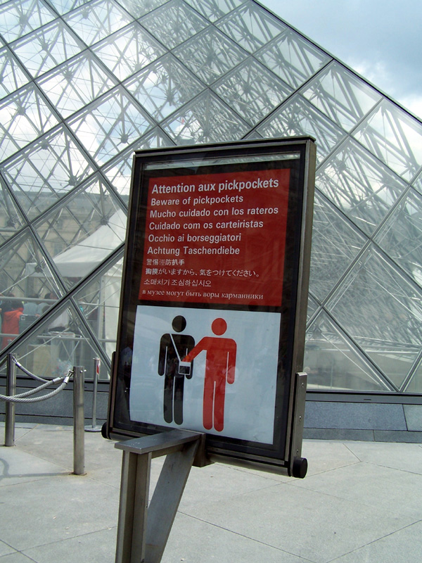 The Louvre has these signs up all over!