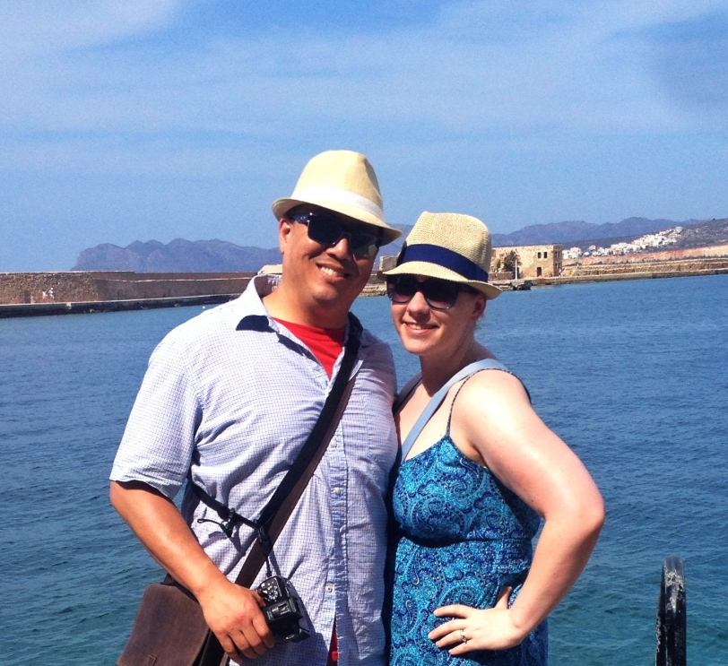 John and I by the harbor (with our hats, bought from one of the markets!)