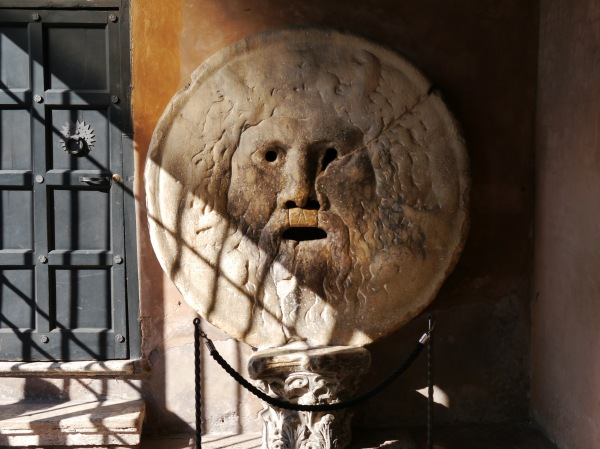 "The ""Bocca della Verità,"" whose legend says that if you tell a lie with your hand in the mouth it will be bitten off. Mine are fully intact!"