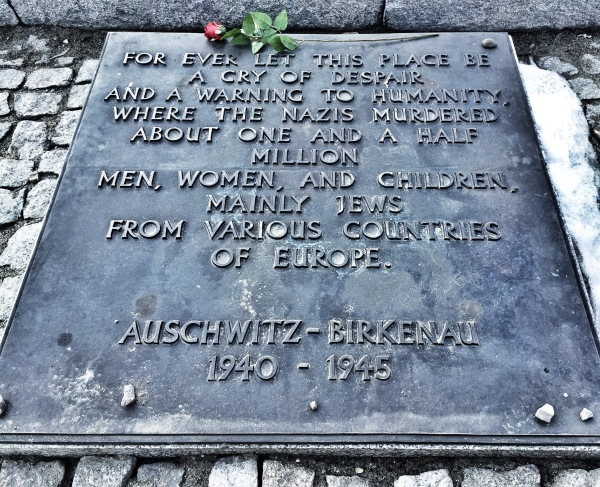 There is one of these plaques written in each language of the known victims - 27 total - and placed at the end of the railroad tracks.