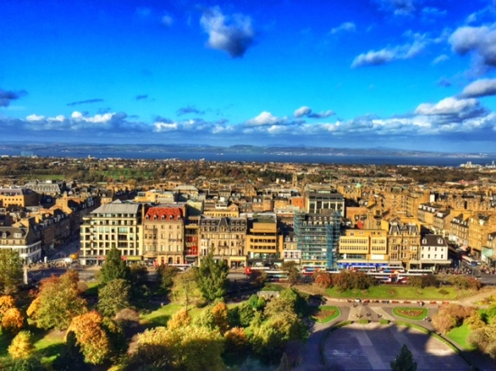 """The view of Edinburgh's """"New Town,"""" and the ocean behind it."""
