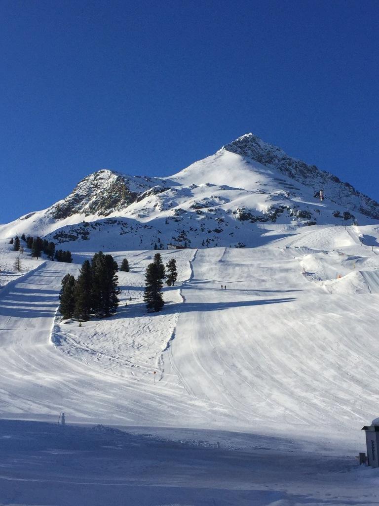 The ski slopes next to the igloos.