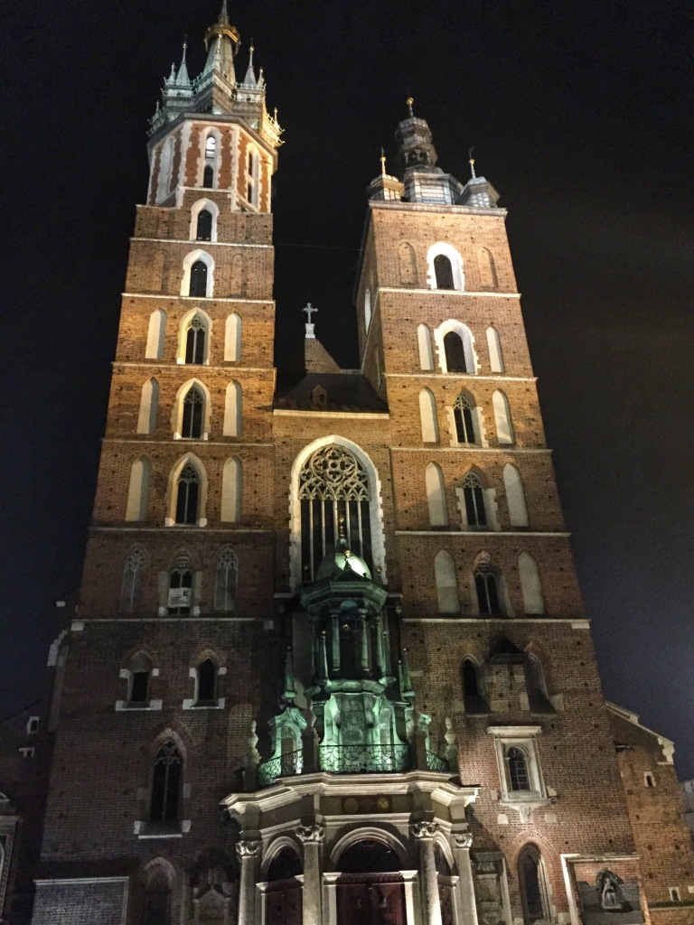 The basilica lit up at night.